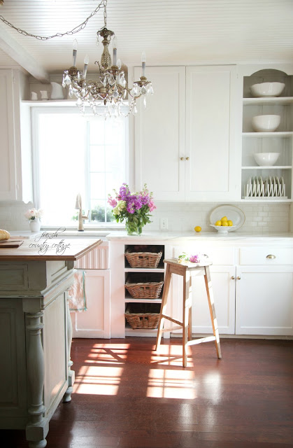 French cottage kitchen with white dishes on shelves