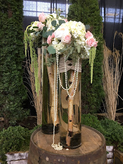 tall birch vase with pearl flower arrangement
