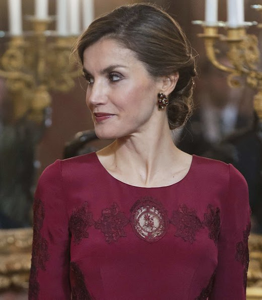 Queen Letizia attends the annual Foreign Ambassadors reception at the Royal Palace. Queen Letizia wore Felipe Varela Long sleeve dress in red. diamond earrings