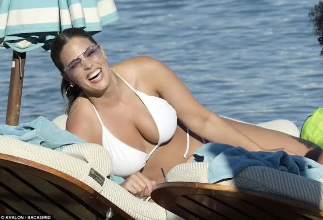 Ashley Graham displays her sizzling figure in barely there bikini