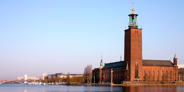 The Stockholm City Hall with its spire that seems to touch the cloud featuring the golden Three Crowns