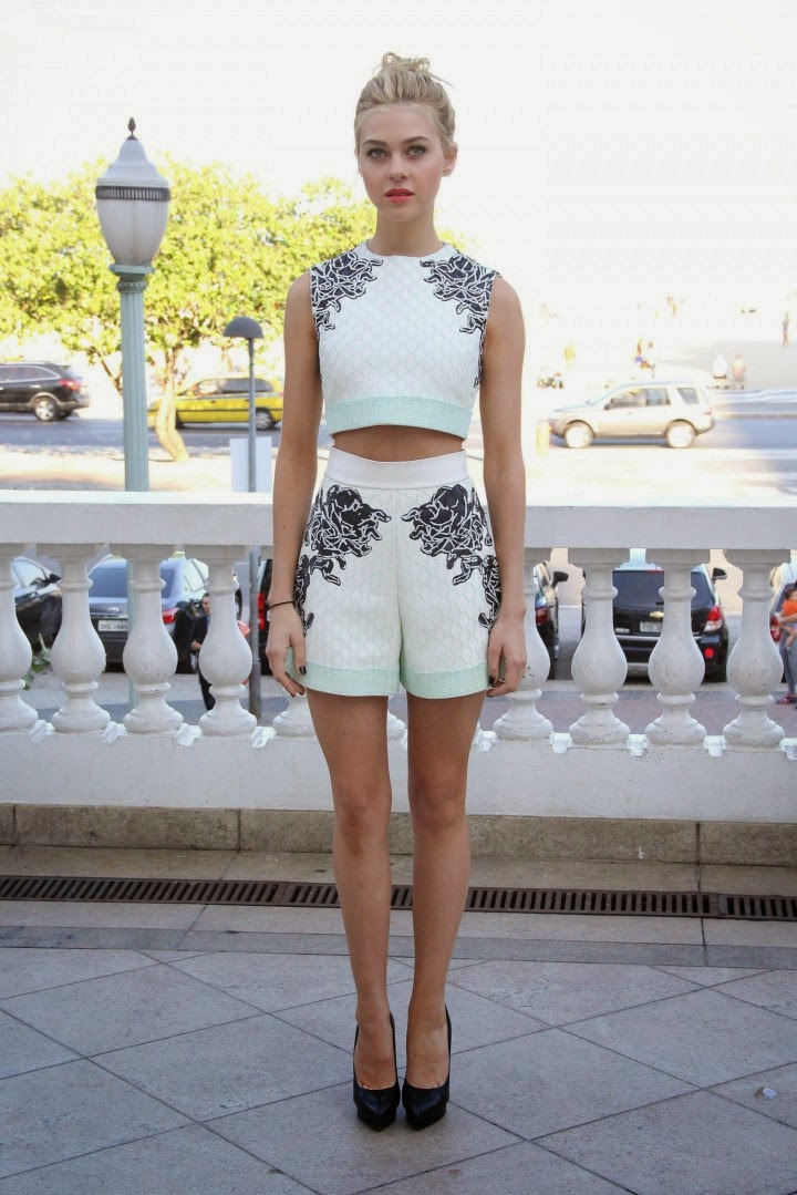 Nicola Peltz in a cropped top and flared shorts at the ...  Nicola Peltz in...