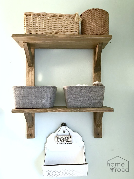 shelves hanging on bathroom wall