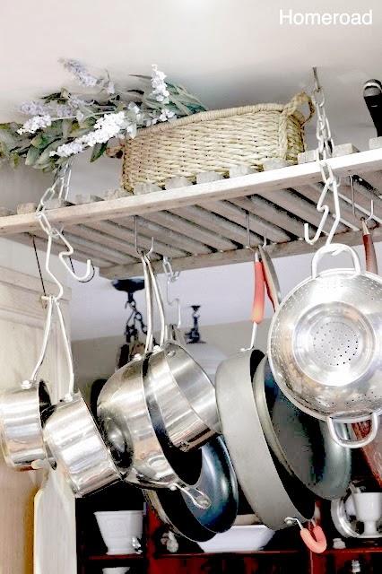 Pot rack full of pots