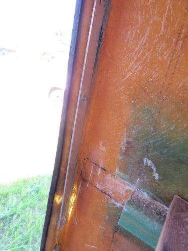 edge of a fiberglass trailer door frame