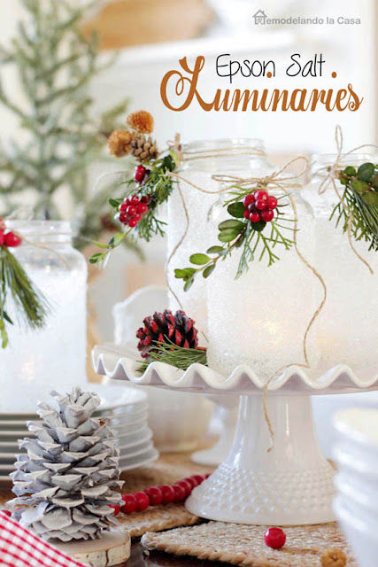 Christmas table centerpiece on white and red with pinecones and white china