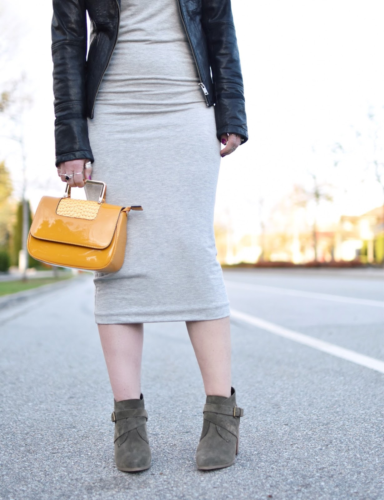 Monika Faulkner outfit inspiration - t-shirt dress, moto jacket, suede ankle boots, patent yellow mini bag