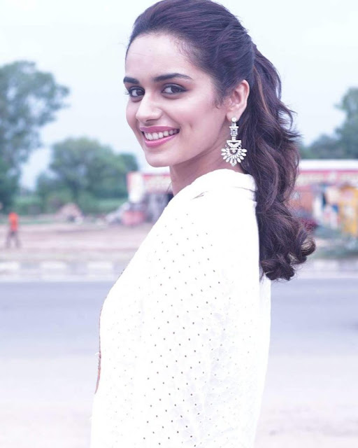 Manushi Chillar wavy hair is making this look even more admirable.