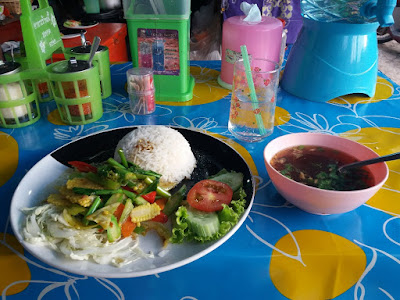 photo of Thai food, rice, vegetables and soup on the island of Ko Jum