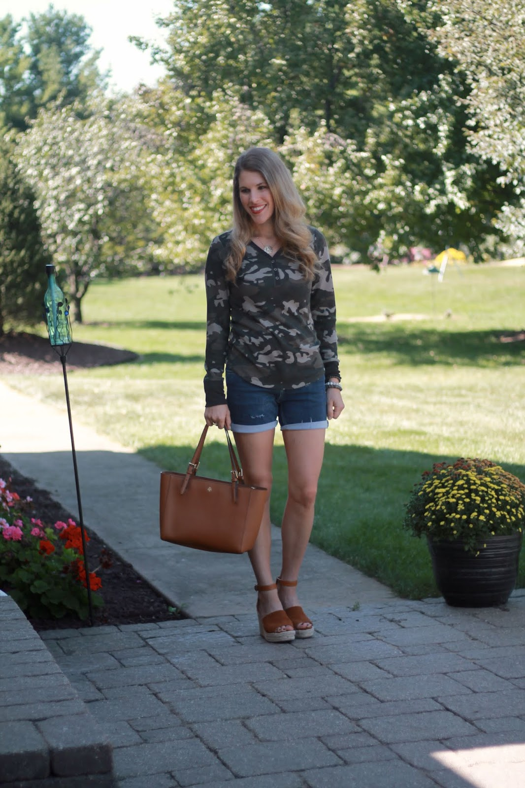camo henley, distressed denim shorts, Tory Burch cognac tote, wedge espadrille sandals