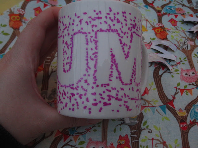 Lettering removed from the mug showing the word mum