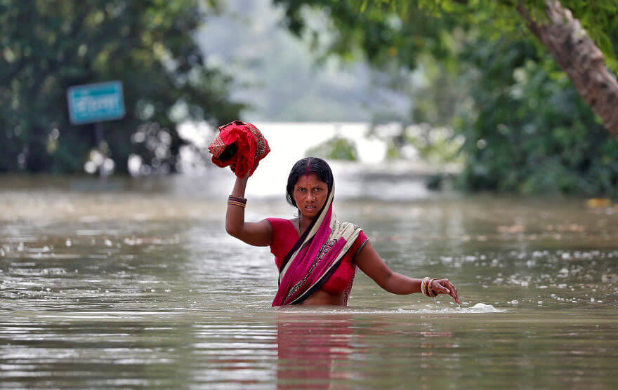 18 Devastating Pictures Of The Flooding In South Asia That Will Shock You - A Woman Wades Through A Flooded Village In Bihar, India