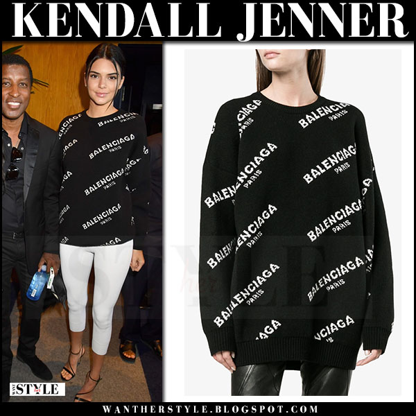 Kendall Jenner in black logo print balenciaga sweater and white leggings what she wore june 21 2017