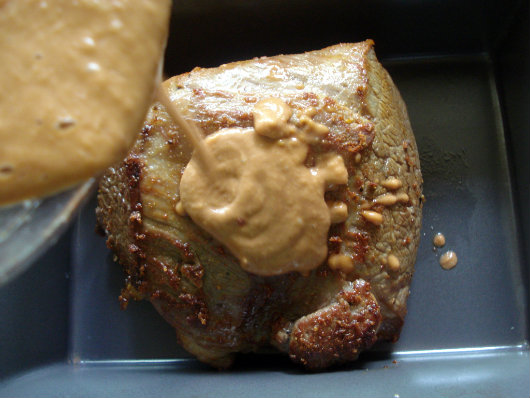 pour peanut butter sauce over meat and roast