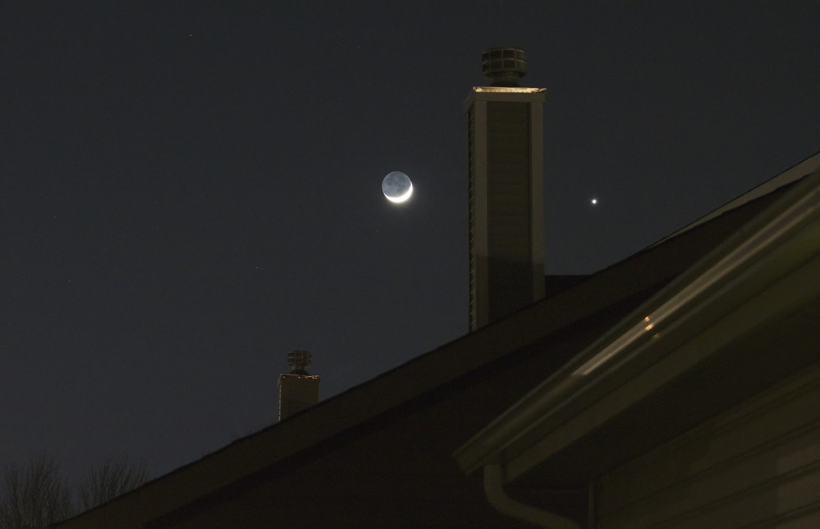 venus moon above roof