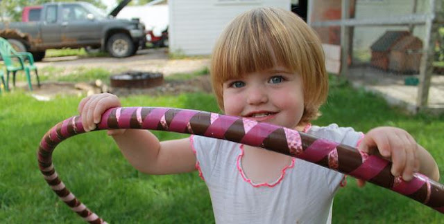 girl with a pink hula hoop
