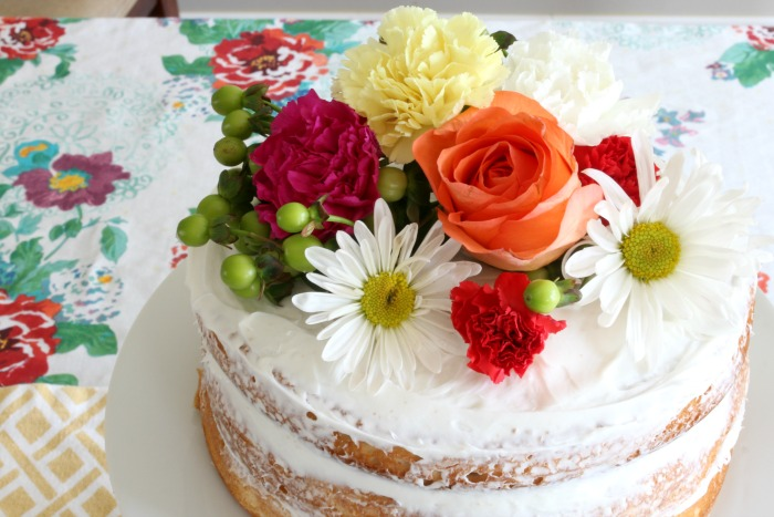 Easy Naked Cake Made Using Boxed Cake Mix & Grocery Store Flowers - www.goldenboysandme.com