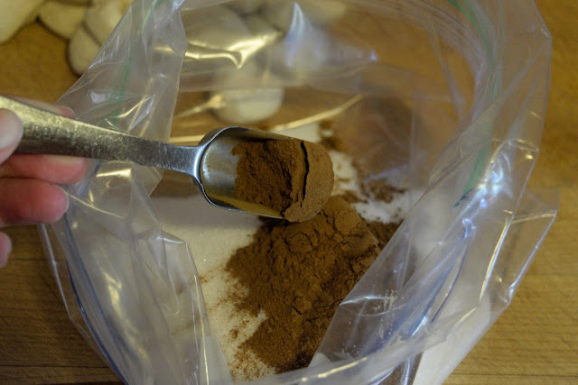 Cinnamon being added to the resealable bag.