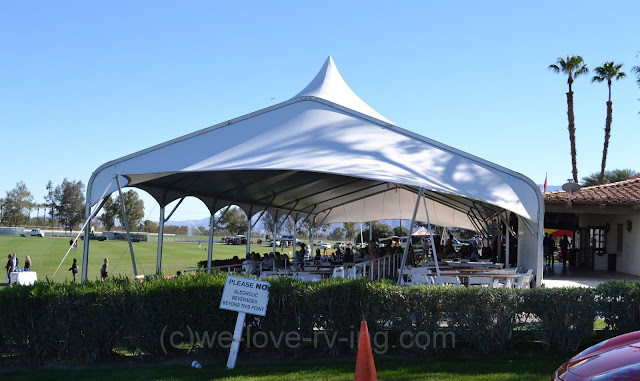 A large tent covers the dining room at the clubhouse