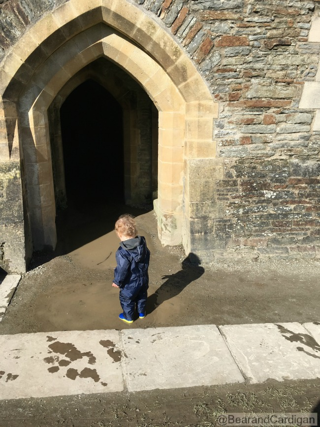 Caerphilly-Castle-with-toddler-in-puddle-in-doorway