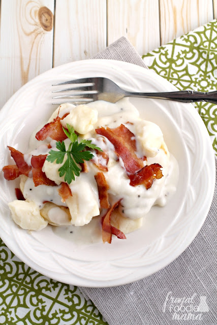 Moist & fluffy potato biscuits are topped with cheese curds, a homemade bacon gravy, and crispy bacon in this Potato Biscuits & Bacon Gravy Poutine.