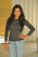 Actress Bhanu Tripathri Pos in Ripped Jeans at Iddari Madhya 18 Movie Pressmeet  0039.JPG