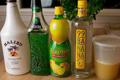 midori june bug cocktail, midori, melon liqueur, coconut rum, malibu rum, banana liqueur, pineapple juice, lemon juice