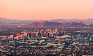 'An urban bullseye for global warming' … Phoenix, Arizona. (Photograph Credit: Dreamframer/Getty Images/iStockphoto) Despite year-round sunshine, Arizona only derives 2-5% of its energy from solar power. (Photograph Credit:  Deirdre Hamill/AP) Click to Enlarge.