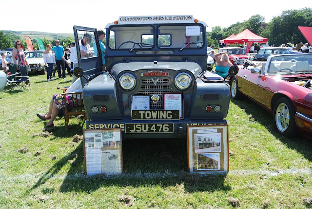 a grey land rover painted with 'grassington service station'