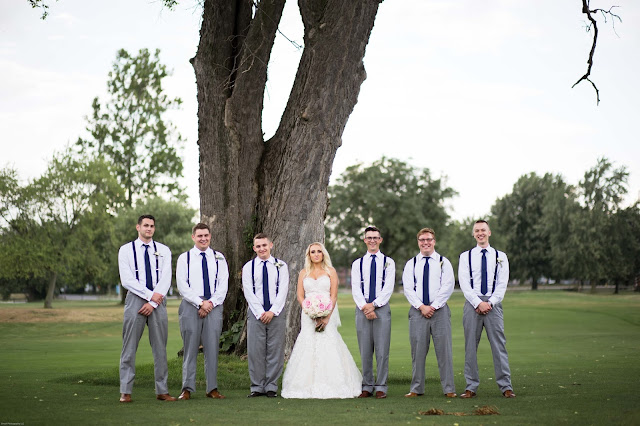 groomsmen with bride at Fern Hill Golf Course
