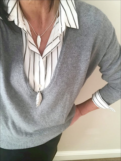 My Midlife Fashion, Zara oversized stripe shirt, Olia jewellery leaf necklace, marks and spencer faux leather a line skirt, hope deep vee slouch pop on knit jumper, mango block heel ankle boots