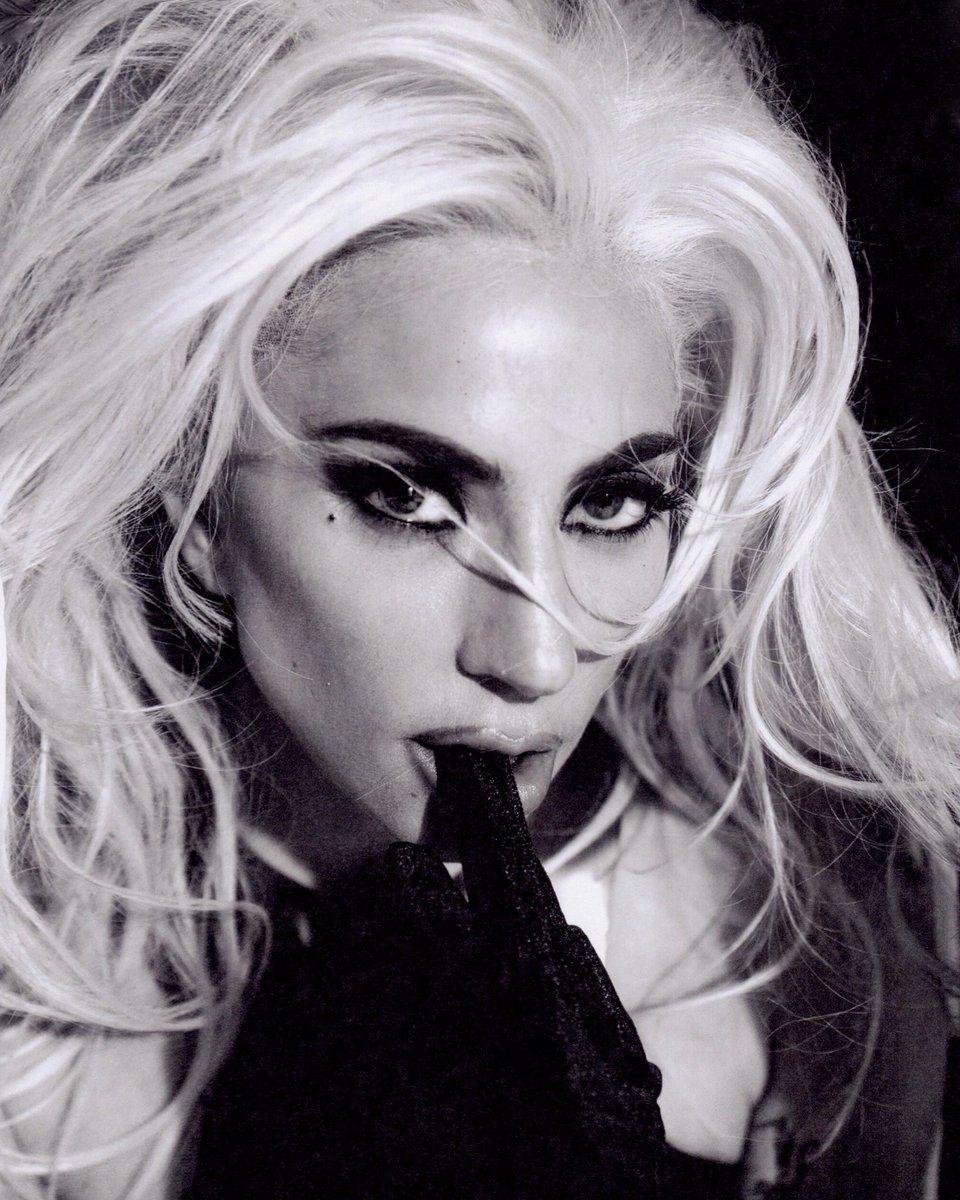 Lady Gaga strikes seductive pose in new photos