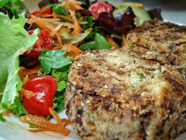 Spicy bean burgers on a plate with salad