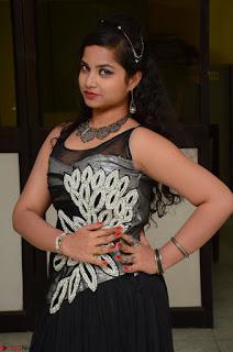 Shrisha Dasari in Sleeveless Short Black Dress At Follow Follow U Audio Launch 052.JPG