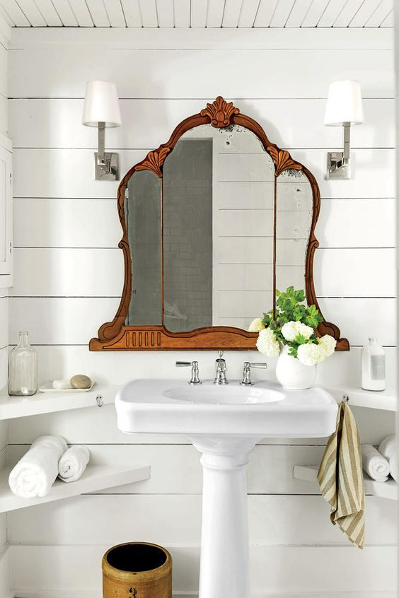 Modern farmhouse bathroom with sliplap, pedestal sink, vintage mirror - found on Hello Lovely Studio