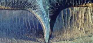 the desert sting,sting fossilized alien desert ready to shine at night,photo of landscapes of deserts of Africa from the air,