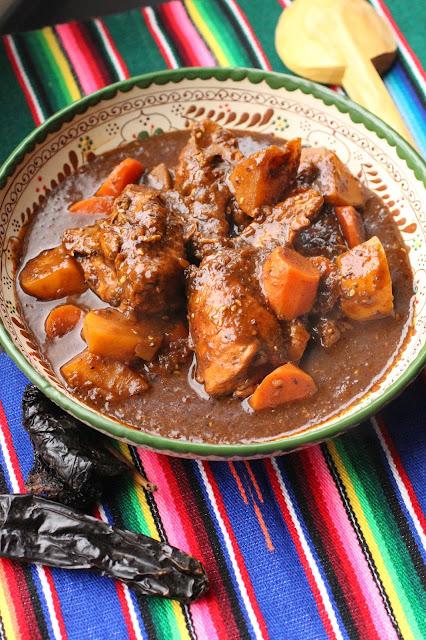 poulet en sauce aux grains de sesame et pain grille