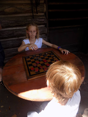 Playing draughts on Tom Sawyer Island