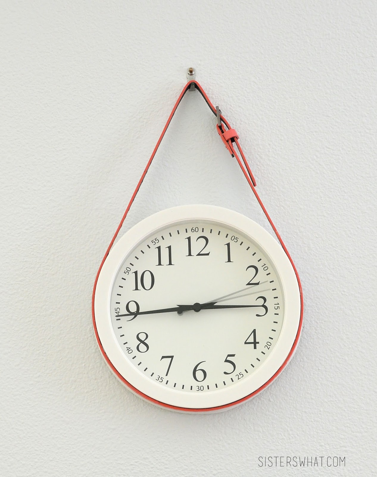 Add a colorful belt to a white, simple clock to add some color to a wall/room