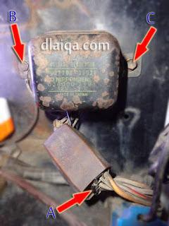 lepaskan voltage regulator yang lama