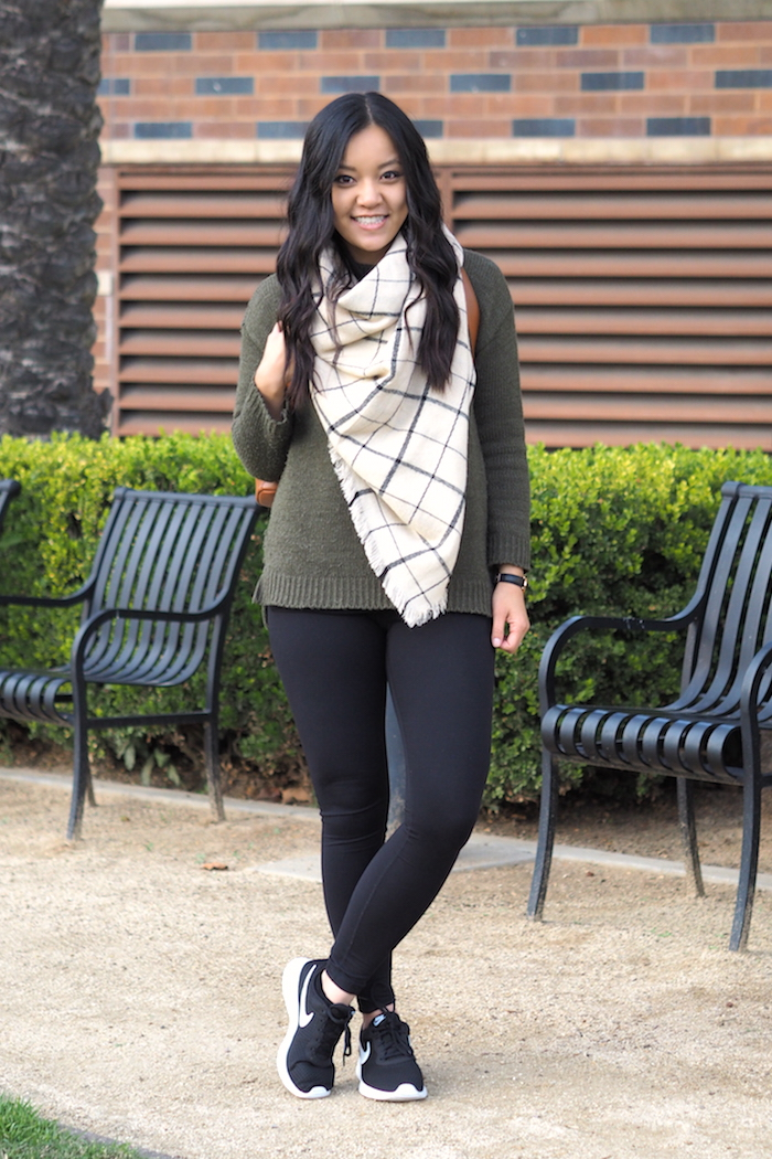 olive sweater + white plaid blanket scarf + leggings + black sneakers