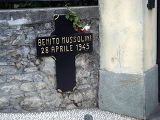 Photo of cross marking place Mussolini was killed