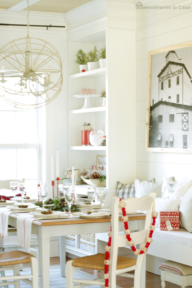 red and white tablescape with felt garland and black and white wall art.