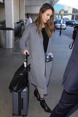 alba-carries-out-her-beauty-regime-in-plane