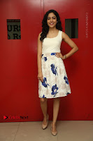 Actress Ritu Varma Stills in White Floral Short Dress at Kesava Movie Success Meet .COM 0164.JPG