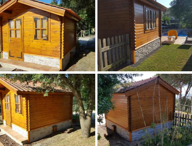 Une cabane en bois avec une plinthe de panneau décoratif Ardoise XL Gris Sable