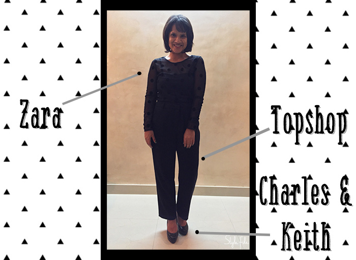 Image of female indian fashion blogger wearing high waist trousers, black pumps and sheer polka dot blouse with a bob haircut