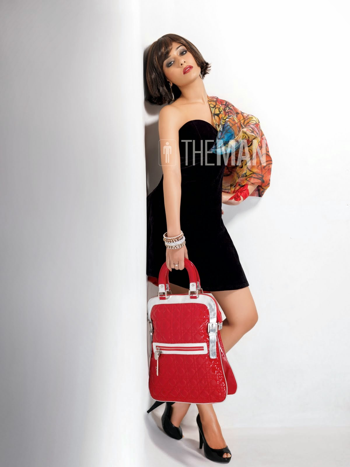 Amrita Rao The Man Magazine Strapless Silky Black Dress with red purse