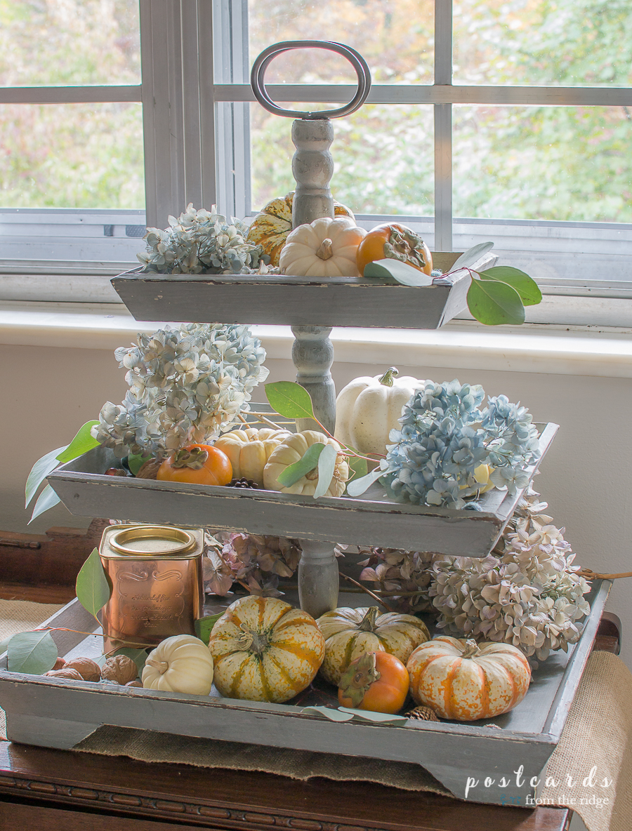 dried hydranges, pumpkins, and persimmons styled in a three tiered tray