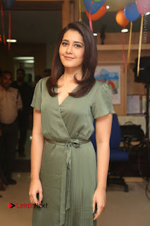 Actress Raashi Khanna Stills in Green Short Dress at Mirchi 95 Suno Aur Mercedes Jeeto Contest  0023.JPG